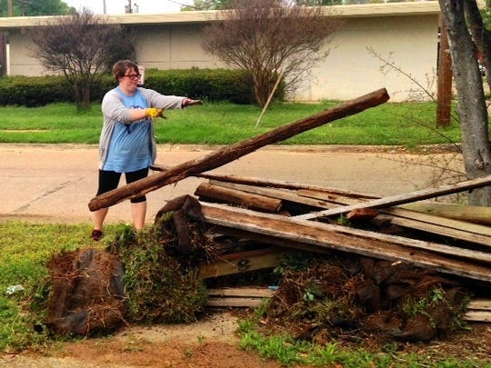 Enterprise Employees move old Lumber from the garden