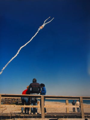 A family from Detroit watches the Challenger launch on Jan. 28, 1986 in Cocoa Beach.