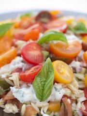 Tomato orzo salad with basil, yogurt and mint.