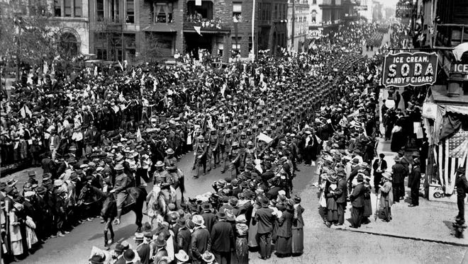 "World War I veterans from Memphis parade down Second Street after their return from France in 1919. A reported 100,000 people turned out to welcome members of the 115th Field Artillery. The ""Great War,"" as World War I was known at the time, took the lives of 230 soldiers from Shelby County."