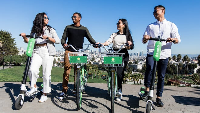 In a photo provided by Lime, riders are seen on their dockless bike and scooter products.