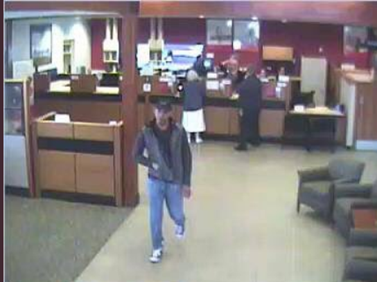 A robber is seen leaving a Wells Fargo Bank in Bloomington