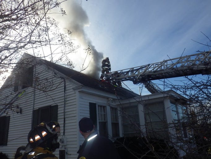 Firefighters work to control a fire at a South Division
