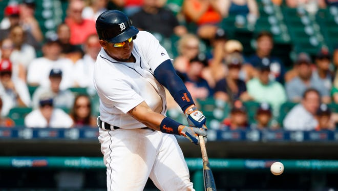 Aug 18, 2016; Detroit, MI, USA; Detroit Tigers first baseman Miguel Cabrera hits an RBI single in the eighth inning against the Boston Red Sox at Comerica Park.