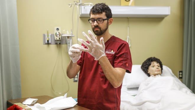 University of Louisiana at Monroe nursing students demonstrate how to properly clean a patient's tracheostomy tube during a lab in Kitty DeGree Hall.