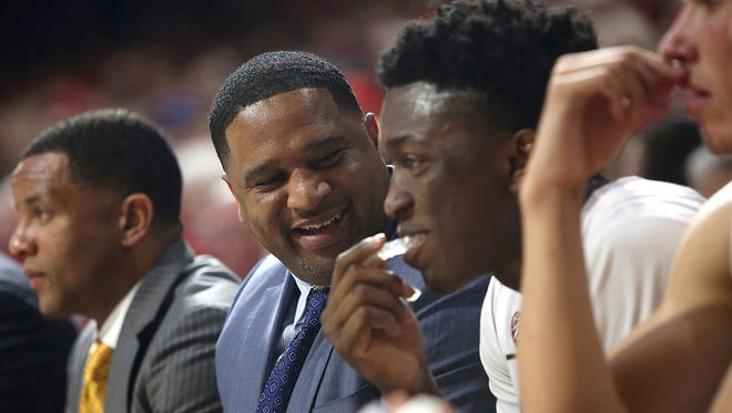 Arizona Wildcats assistant coach Book Richardson jokes around with Arizona Wildcats forward Stanley Johnson (5) on the bench in the second half during a game at McKale Center in Tucson on Feb. 19, 2015. Arizona won 87-57.