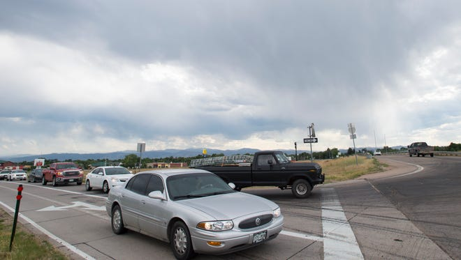 Traffic waits to turn onto Cleveland Avenue from the Interstate 25 off-ramp in Wellington on Friday. Congestion during peak traffic times creates delays on the interstate near the main street through the northern Larimer County town.
