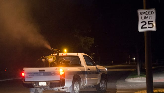A truck deployed by Larimer County sprays mosquito insecticide on the east side of Fort Collins in this file photo.