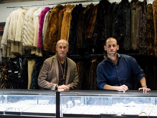 From left, President of American Jewelry and Loan, Les Gold, poses with his son and Vice President of American Jewelry and Loan, Seth Gold, on Thursday, Feb. 1, 2018 at American Jewelry and Loan in Detroit.