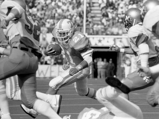 Tennessee's Jeff Powell, a former Whites Creek standout, looks for room to run up field against Vanderbilt on Nov. 30, 1985.