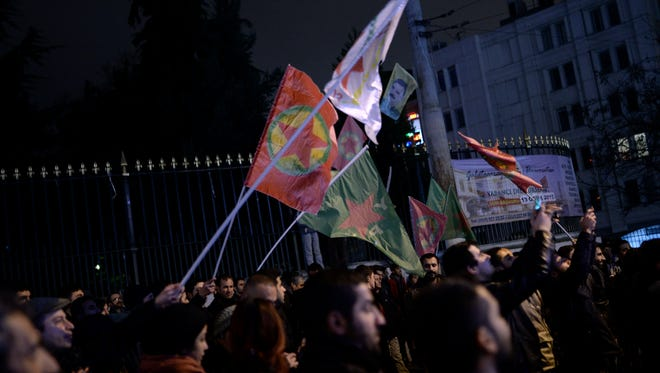 Kurds wave flags of outlawed rebel group to celebrate in Istanbul, Turkey, on Jan. 26, 2015, hours after Kurdish fighters backed by intense U.S.-led airstrikes pushed the Islamic State group entirely out of a key Syrian town on Monday.