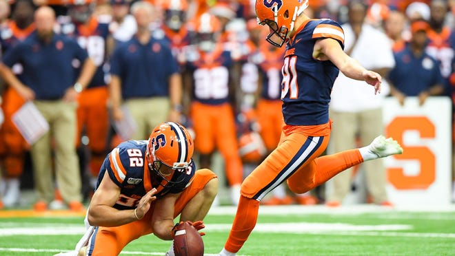 In this 2019 photo, Syracuse place kicker Andre Szmyt (91) kicks a field goal  against the Clemson Tigers during a game at the Carrier Dome. Szmyt is the 2018 Lou Groza winner and is on the 30-player watch list for 2020.