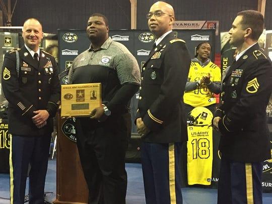 Evangel coach Byron Dawson is recognized by the U.S.