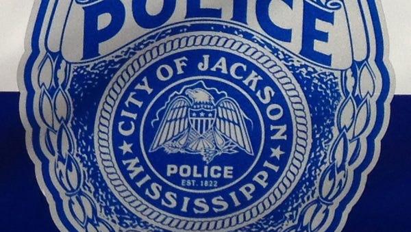 A Jackson police officer shot a suspected burglar Monday