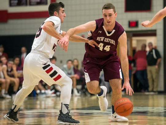 New Oxford's John Wessel (44) drives the ball toward the hoop, Friday, Jan. 19, 2018. The South Western Mustangs beat the New Oxford Colonials, 48-44, earning the Mustangs' second win of the season.