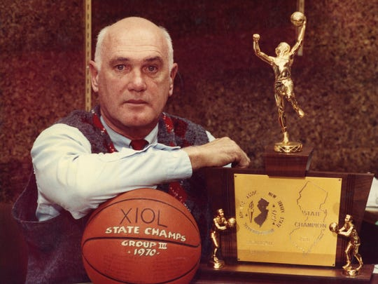 Former Long Branch coach Bob Walsack poses in 1991 with the state championship trophy from the Green Wave's Group III title from the 1969-70 season.