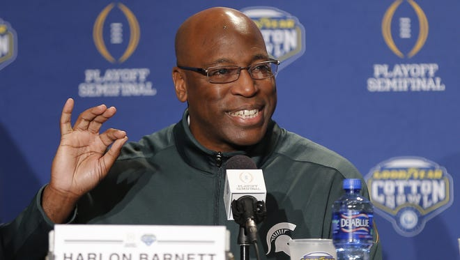 Michigan State defensive coordinator Harlon Barnett speaks Dec. 27, 2015, in Dallas.