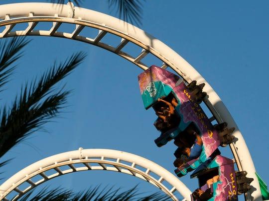People ride the Desert Storm roller coaster at Castles 'n' Coasters in Phoenix.