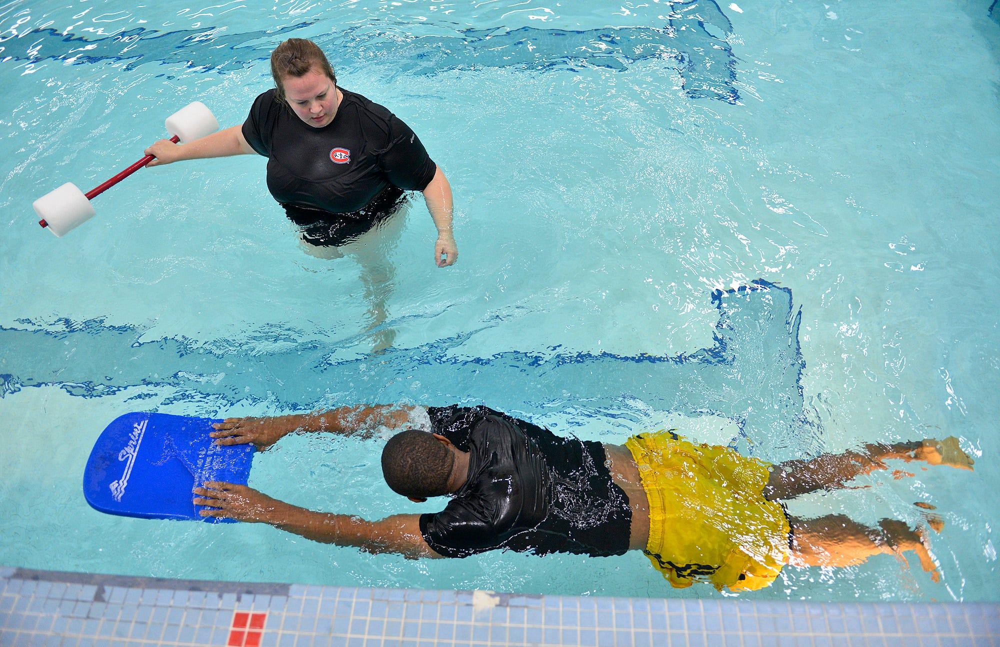 XXX AP206084061390. Megan Balach Watches An Adult Swimming Studentu0027s  Technique ...