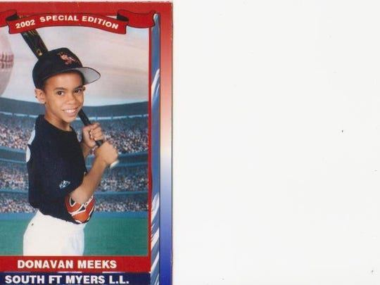 Meeks as a nine-year-old Little League player