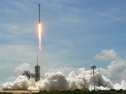 A SpaceX Falcon 9 rocket takes off from Kennedy Space