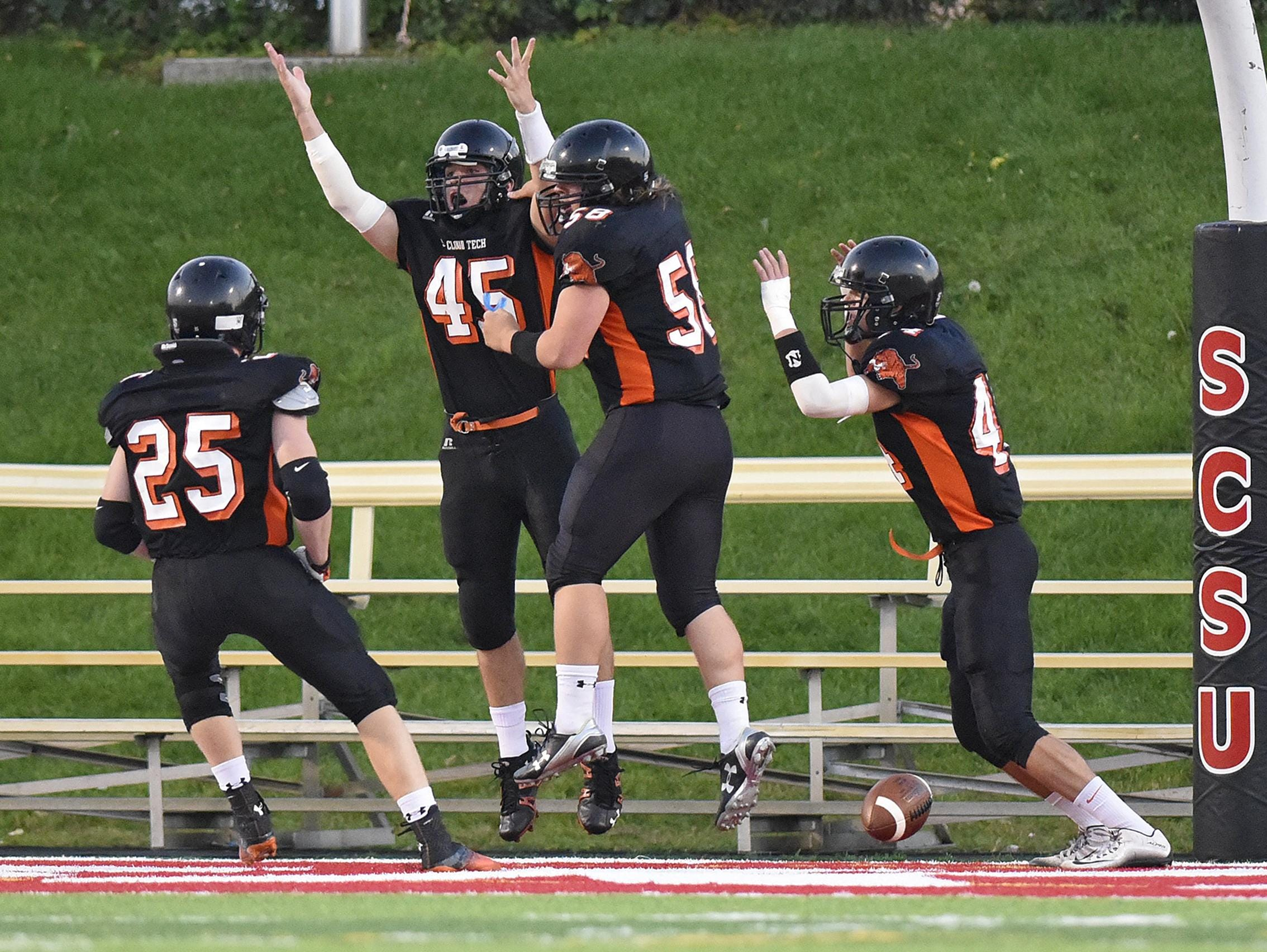 St. Cloud Tech players celebrate a touchdown during the first half of Friday's game at Husky Stadium in St. Cloud.