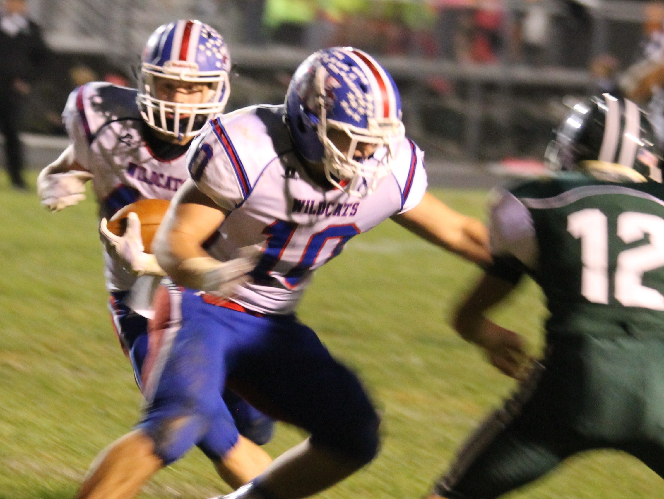 Running back Spencer Clowery, left, finds a hole in the line. Clowery finished with six total touchdowns.