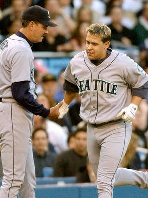 York High grad Dave Myers, left, coached third base for the Seattle Mariners for four seasons. Here, he congratulates Bret Boone after a home run against New York's  Roger Clemens in 2003.