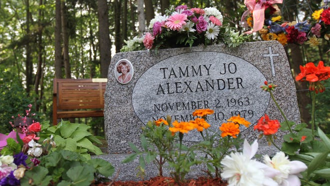 The new grave stone with Tammy Jo Alexander's name is etched on the back side of the old headstone.  It is now facing out  at Greenmount Cemetery in Dansville.  A bench was also added nearby.
