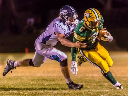 CMR's Karl Tucker II, 6, fights for extra yardage as