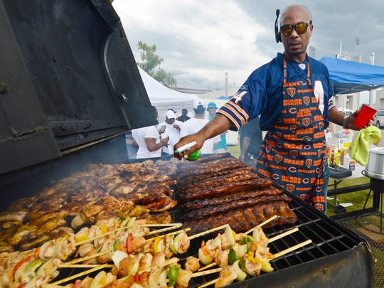 SEPT. 10, 2016 - TSU 40, JSU 26: Reginald Sanders from Hop's Catering, prepares everything you can imagine on the grill during the 27th annual Southern Heritage Classic in Memphis at the Liberty Bowl. Thousands were on hand for the annual event.