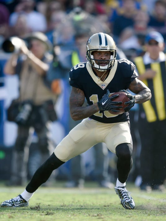 In this Sunday, Nov. 26, 2017 file photo, New Orleans Saints wide receiver Ted Ginn Jr. runs with the ball during the first half of an NFL football game against the Los Angeles Rams in Los Angeles. The chance to play in elite passing offense featuring quarterback Drew Brees was one factor that brought receiver Ted Ginn Jr. to the Saints. An opportunity to make the Carolina Panthers pay for letting him walk in free agency was another. The Saints play the Panthers on Sunday, Dec. 3, 2017.  (AP Photo/Kelvin Kuo, File)