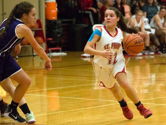 St. Philip guard Taylor Pessetti (12) drives the basket