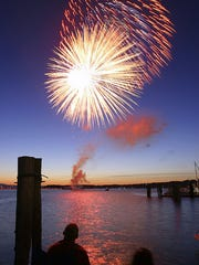 Fireworks pour over Burlington Bay Sunday, July 3, 2005, amidst cool temperatures and a slow-setting sunset.