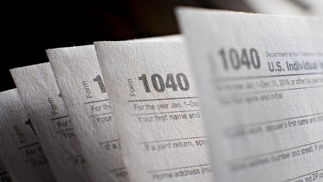 Daniel Acker, Bloomberg U.S. Department of the Treasury Internal Revenue Service (IRS) 1040 Individual Income Tax forms for the 2014 tax year are arranged for a photograph in Tiskilwa, Illinois, U.S., on Monday, March 16, 2015. The deadline for filing 2014 U.S. income taxes is Wednesday, April 15, 2015. Photographer: Daniel Acker/Bloomberg ORG XMIT: 543321767