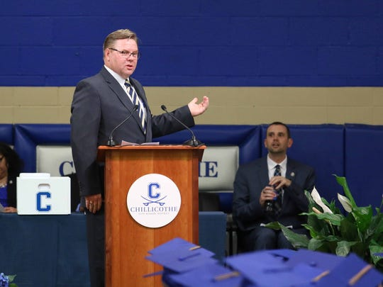 Jon Saxton, then Chillicothe City Schools superintendent, speaks at a recent CHS graduation as Jeff Fisher, then CHS principal, listens.