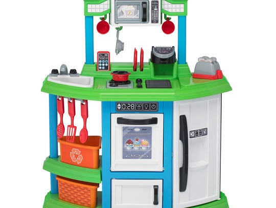 This plastic toy kitchen is equipped with all the tools