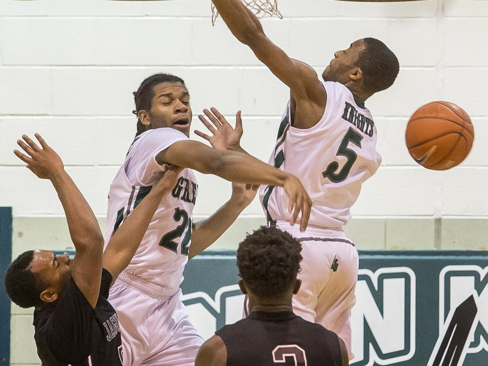 Mount Pleasant's Keynon Fetlow (left) blocks a shot from Appoquinimink's Keith DeLoatch in the first half of Mount Pleasant's 79-60 win over Appoquinimink High School at Mount Pleasant High School in Wilmington on Tuesday evening.