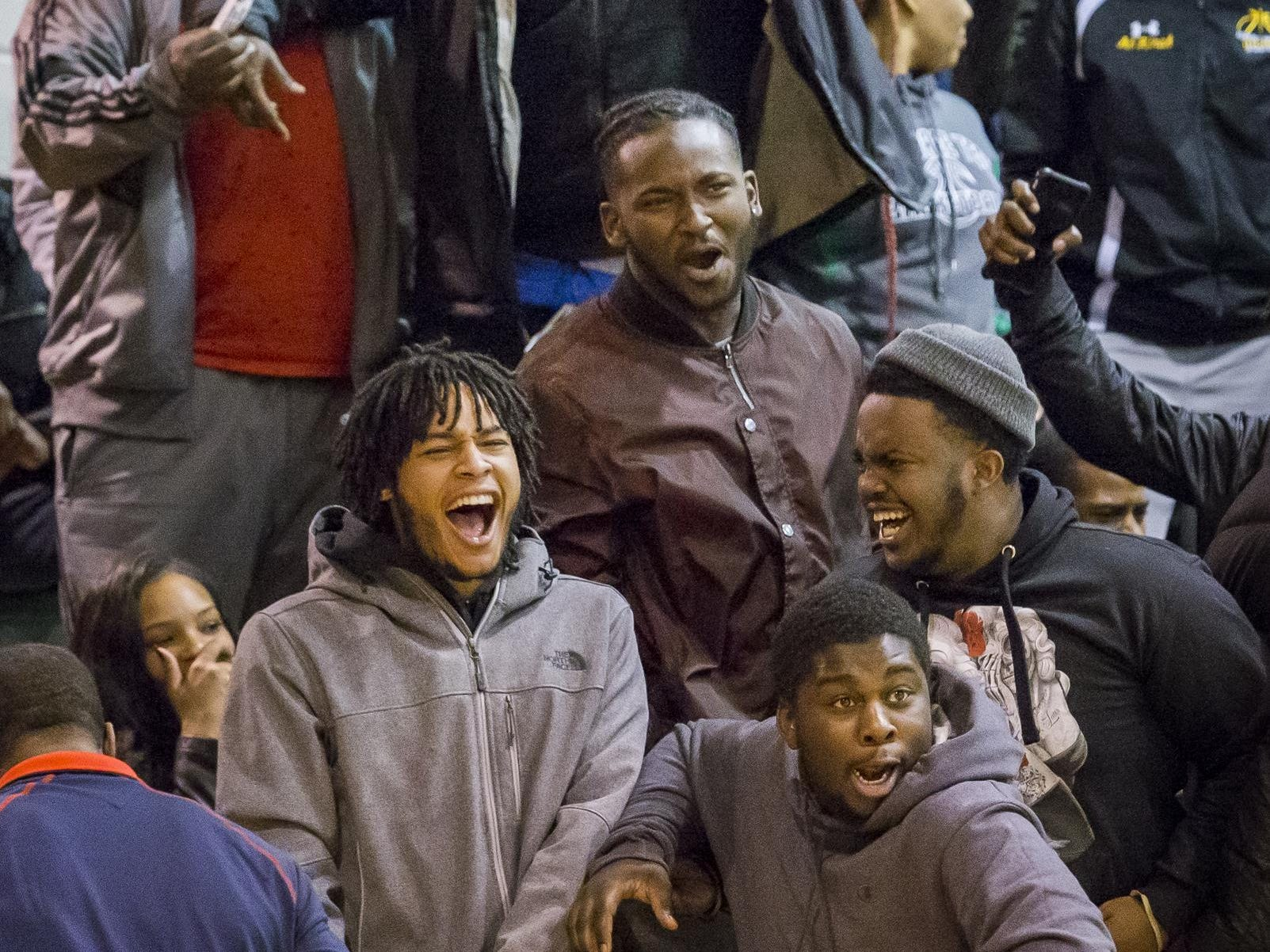Mount Pleasant fans celebrate a dunk by Mount Pleasant's KVonn Cramer in the first half of Mount Pleasant's 79-60 win over Appoquinimink High School at Mount Pleasant High School in Wilmington on Tuesday evening.