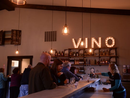 Guests taste a variety of wines made by Salted Vines in Frankford, Delaware.