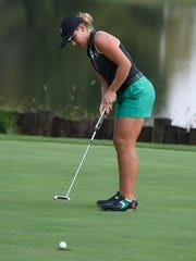 Hadley Walts of North drains a putt on the 18th hole during the Girls Golf Regional at Country Oaks Golf Club in Montgomery Saturday.  Walts was the individual medalist after birding a playoff hole.  North won the Regional with a 296.