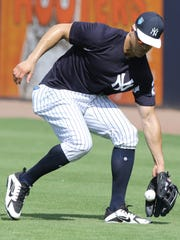Yankees workout this afternoon. Giancarlo Stanton fields. A ground ball in the outfield during batting practice.