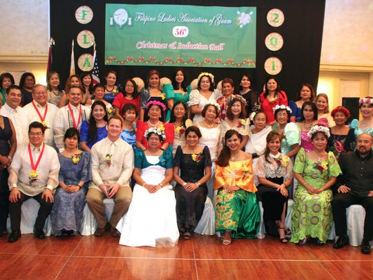 Dignitaries, elected officials, and community leaders gathered for a large group photo during the Filipino Ladies Association of Guam's 56th Christmas and Induction Ball on Jan. 6, 2017.