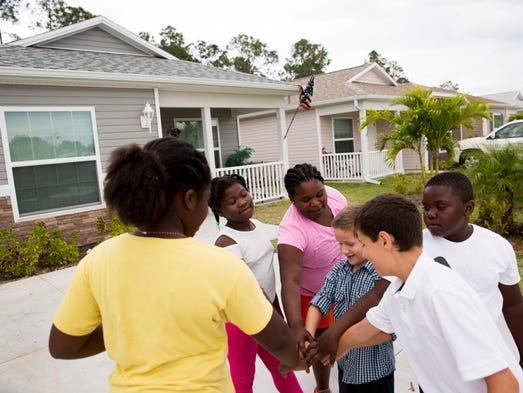 Neighborhood children Fabiana Jean-Baptiste, 9, from