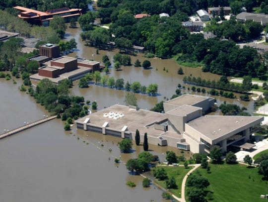 Floodwaters surround the University of Iowa's Hancher