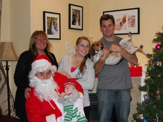 Owen, at right, and Allie, center, pose for a Christmas