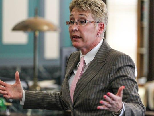 Monika Burgett's attorney  M.J. Hugan speaks to the