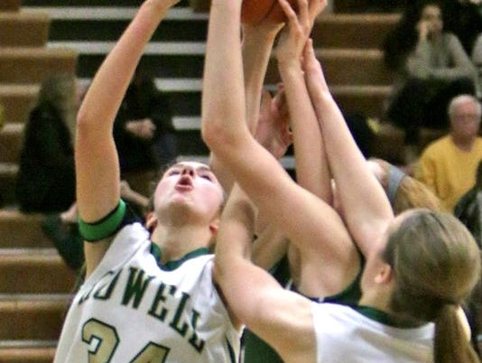 Howell's Erin Honkala, left, had a well-rounded game with 12 points, seven rebounds, seven steals and four blocks to lead the Highlanders in their season-opening victory vs. Fenton.