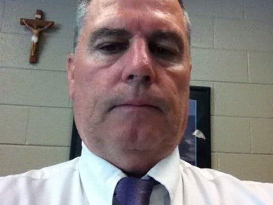 Father Ryan wrestling coach Pat Simpson.