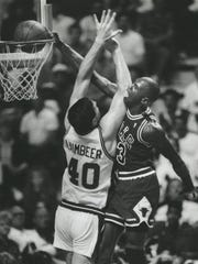 Michael Jordan slams home two over Pistons center Bill Laimbeer.